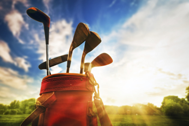 Golf equipment. Professional clubs at sunset